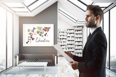 Businessman in room with knowledge sketch Royalty Free Stock Images