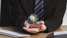 Businessman with a rotary globe in his hand Royalty Free Stock Photo