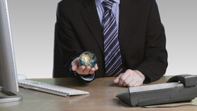 Businessman with a rotary globe in his hand Stock Image