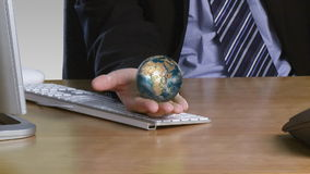 Businessman with a rotary globe on his open hand Royalty Free Stock Photography