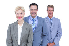 Businessman in a row with his business team Stock Photography