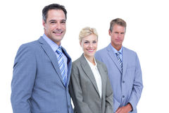 Businessman in a row with his business team Royalty Free Stock Photos