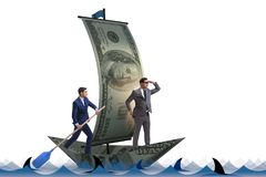 The businessman rowing on dollar boat in business financial concept. Businessman rowing on dollar boat in business financial concept Stock Photography