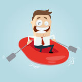 Businessman in rubber boat Stock Images