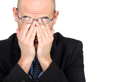 Businessman rubbing his eyes Stock Photo