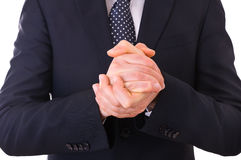 Business man rubbing his hands together. Royalty Free Stock Photos