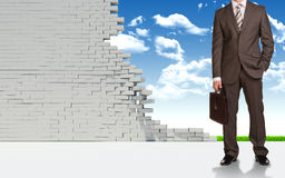 Businessman and ruined brick wall Stock Image