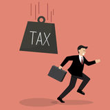 Businessman run away from heavy tax Royalty Free Stock Photography