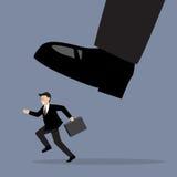 Businessman run away from stomping foot Royalty Free Stock Photos
