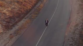 Man in suit runs on the road stock video footage