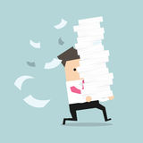Businessman run holding a lot of papers in his hands Stock Photo