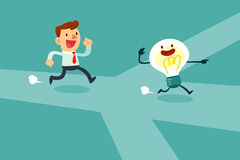 Businessman run after idea bulb through the crossroad Royalty Free Stock Image