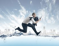 Businessman run on the water Royalty Free Stock Image