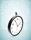 Businessman runing on clock Stock Image