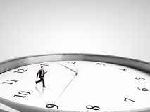 Businessman runing in clock Royalty Free Stock Photography
