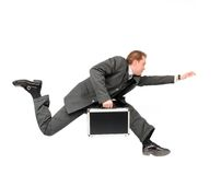 Businessman running. Running businessman carrying a briefcase, isolated on a white background Royalty Free Stock Photo