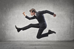 Businessman Running. A businessman is running Royalty Free Stock Photography