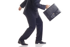 Businessman running away Stock Photo