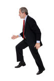 Businessman running away Royalty Free Stock Images