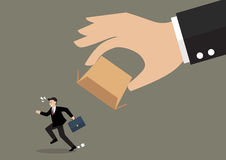 Businessman running away from cardboard box Stock Images