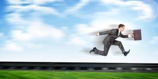 Businessman running away Stock Photo