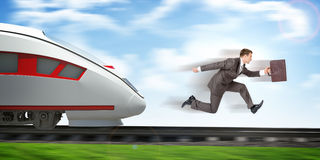 Businessman running away from train Royalty Free Stock Images