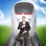 Businessman running away from train Stock Photos