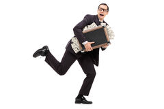 Businessman running with a bag full of money. Isolated on white background stock images