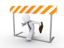 Businessman running below obstacle Royalty Free Stock Photo