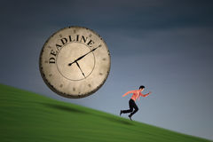 Businessman running with a big clock Royalty Free Stock Images