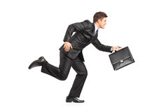 Businessman running with a briefcase. On white background Royalty Free Stock Images