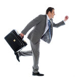 Businessman running with a briefcase Royalty Free Stock Images