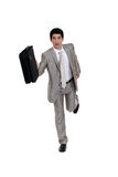 Businessman running Royalty Free Stock Image