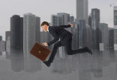 Businessman running with a briefcase Royalty Free Stock Photos