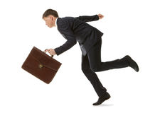 Businessman running with a briefcase Royalty Free Stock Image