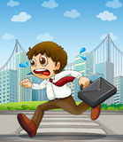A businessman running with a case in his hand Stock Photography