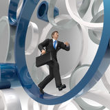 Businessman running in the circle Royalty Free Stock Images