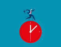 Businessman running on clock representing deadline. Concept  Royalty Free Stock Photos