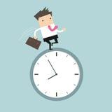 Businessman running on clock Stock Images