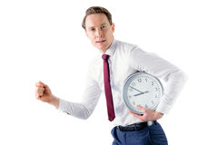 A businessman running with clock Royalty Free Stock Photos