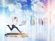 Businessman running after dollar. Businessman running on treadmill after dollar banknote suspended on fishing-rod. New York city background. Double exposure, 3D Royalty Free Stock Images