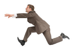 Businessman running fast Stock Images