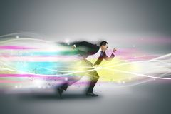 Businessman running fast and tech concept royalty free stock photography