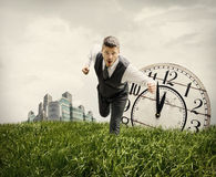 Businessman Running Through Field Stock Image