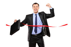 Businessman running at the finish line Royalty Free Stock Image