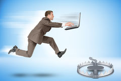 Businessman running forward. Businessman with laptop running forward to beartrap Royalty Free Stock Image
