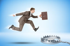 Businessman running forward. Businessman with suitcase running forward to beartrap Royalty Free Stock Images