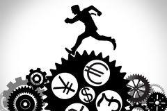 Businessman running. On the gear with currency symbol, dollar, euro,pound,yen Royalty Free Stock Photo