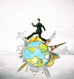Businessman running on globe with sights. Businessman running on abstract globe with sights on city background. Traveling concept Royalty Free Stock Photos