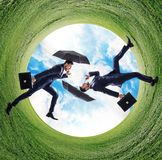 Businessman running into green grass circle. Stock Images